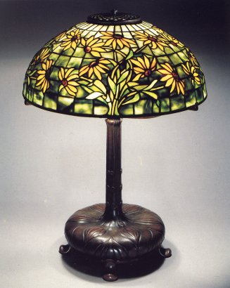 A Black Eyed Susan Leaded Glass And Bronze Table Lamp