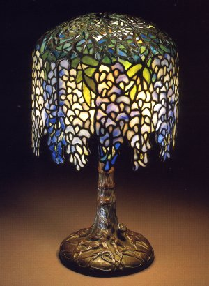 A Pony Wisteria Leaded Glass And Bronze Table Lamp By